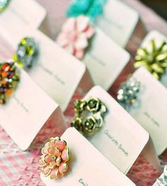 Vintage brooch as an accent on the escort card. Such a cute idea and goes so well with the vintage wedding theme!