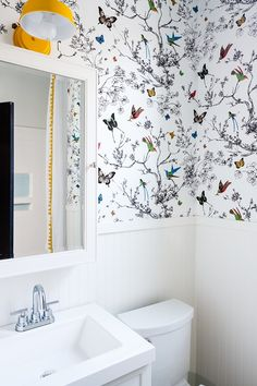 bathroom wallpaper This happy bathroom keeps things simple with bright white beadboard but adds a dose of whimsical with Birds and Butterflies wallpaper by Schumacher and a saffron painted metal light fixture. Half Bathroom Wallpaper, Bird Wallpaper, Butterfly Wallpaper, Rustic Bathrooms, Chic Bathrooms, Small Bathroom, Bathroom Ideas, Neutral Bathroom, Bathroom Closet
