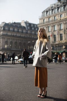 The proportions, the neutral colors, the detail of her bracelet cinching her sweater: perfect. - via The Sartorialist