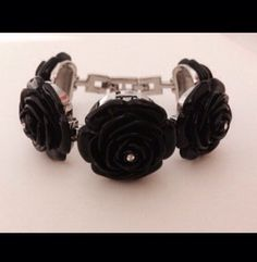 A personal favorite from my Etsy shop https://www.etsy.com/listing/477438998/betsey-johnson-black-rose-lucite-silver