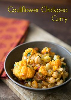 Delicious curry with cauliflower, chickpeas, onion, and tomato on SimplyRecipes.com #vegan #recipe