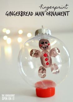 Fingerprint Gingerbread Man Ornament. Create a keepsake for your christmas tree with your child this holiday season. #eduspin #christmas #ornament #gingerbreadman