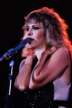 Stevie onstage   ~ ☆♥❤♥☆ ~   during Fleetwood Mac's 1982 'Mirage' tour ~ her glowing eyes are stunning here, and she's wearing that black beaded tunic ~  https://en.wikipedia.org/wiki/Mirage_(Fleetwood_Mac_album)