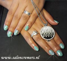 mint color nail art with silver studs