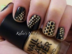 black and gold polka dot nails