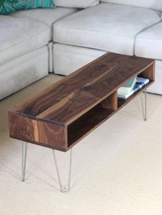 Our Mid Century Modern inspired coffee table is handmade using the highest quality hardwood-- available in your choice of Walnut, White Oak or Ash. We offer 2 sizes at checkout.  This is NOT cheap Pine with stain OR plywood. We use Stainless Steel Hairpin legs rather than raw steel so they will never tarnish or rust. (Legs are handmade in Portland Maine)  The dimensions of this cocktail table makes it perfect for a smaller space or apartment while maintaining a high level of quality and…