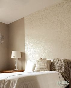 Large Fabric Damask stencil on a taped-off bedroom wall panel by Bon Temps Beignet. Looks very custom and cuts down on the amount of stenciling!