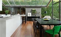 Love the modern home, but the green wall outside definitely wins.