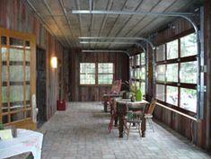 Wow!!! Garage Doors as windows. Love this idea for a porch!!