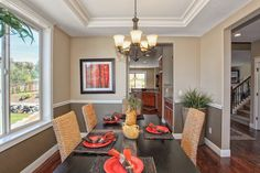Tray ceilings and two-tone paint on the walls adds a touch of elegance to your formal dining room.