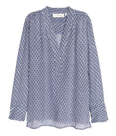 Check this out! Wide-cut V-neck blouse in crinkled fabric with a printed pattern. Long sleeves with slits at cuffs. Slits at sides. Slightly longer at back. - Visit hm.com to see more.