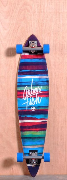 """The Arbor Fish Longboard Complete is designed for Cruising and Carving. Ships fully assembled and ready to skate! Function: Cruising, Carving, Features: Pintail, Concave Material: 7 Ply Sustainable Maple, Koa Topsheet Length: 39"""" Width: 8.75"""" Wheelbase: 27.75"""" Thickness: 7/16"""" Weight: 3lbs 5oz Hole Pattern: New School Grip: Clear"""