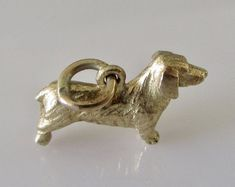 Gold Dachshund or Sausage Dog Charm or Pendant Gems Jewelry, Bridal Jewelry, Jewellery, Charm Braclets, Long Haired Dachshund, Vintage Charm Bracelet, Unusual Rings, Lucky Charm, Dachshunds