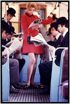 Paulene Stone reading Vogue and newspapers, on London Underground (1960s). For Vogue. Brian Duffy (English, 1933-2010).