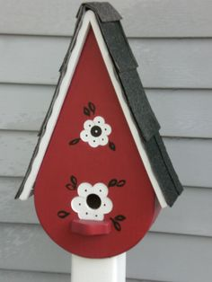 Bird house along front of house