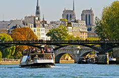 One of Paris's most iconic places, the Seine river comes alive with with people sitting at its banks.