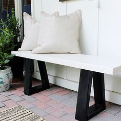 Looking for simple, modern outdoor seating? For less than the price of one West Elm bench, you could fill an entire backyard with near-identicalslab bench knockoffs-- thanks to this easy tutorial. The clean lines and minimalist black-and-white color combination of the seating complements any and all outside decor.