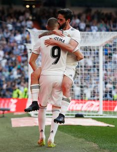 Isco Alarcon and Karim Benzema of Real Madrid celebrate after scoring the opening goal during the La Liga match between Real Madrid CF and RC Celta de Vigo at Estadio Santiago Bernabeu on March Get premium, high resolution news photos at Getty Images Madrid Football Club, Equipe Real Madrid, Isco Alarcon, Professional Football, European Football, Uefa Champions League, Soccer Players, Running, Celebrities