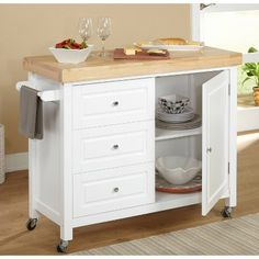 For storage and serving, the Monterey Kitchen Cart just makes sense. This convenient cart adds to the ambiance with its two-tone finish and thick. White Kitchen Cart, Kitchen Island With Stove, Kitchen Island Decor, Modern Kitchen Island, Kitchen Island With Seating, Kitchen Islands, Kitchen Tables, Kitchen Carts On Wheels, Kitchen Ideas