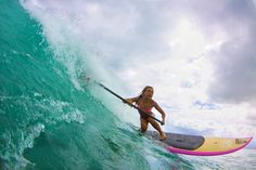 http://www.vaninawalsh.com/  Stand up Paddle Surfing Hawaii on her KM Hawaii SUP