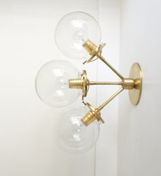 Rose  triple glass globe Solid Brass wall lamp by TripleSevenHome