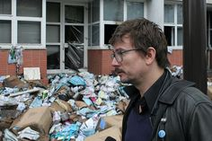 Cartoonist Luz in front of the burned offices of Charlie Hebdo.