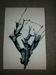 Straw blown cherry trees (before painting on blossoms).  Water down black paint and put a bit on the paper and blow on with a straw.
