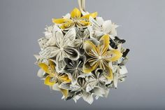 Beautiful newspaper flower pomanders and bouquets for purchase from Etsy's WhetherPaperworks.