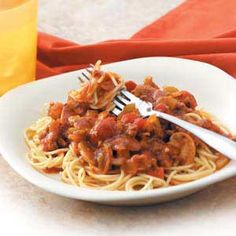 """Mom's Spaghetti Sauce Recipe -""""Mom made this when we were kids, and it was always my first choice for birthday dinners,"""" recalls Kristy Hawkes in South Ogden, Utah. """"Now I do the prep work in the morning and just let it simmer all day. When I get home, all I have to do is boil the spaghetti, brown some garlic bread and dinner is on!"""""""