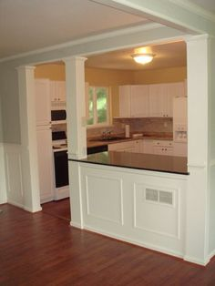 Kitchen Pass Through - I want something like this, but more countertop overhang for bar stools on the dining room side. Or shelves underneath.