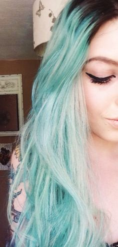 Blue hair and winged liner.