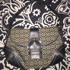 💕TAKING OFFERS💕Black Coach Purse Pre owned but in pretty good condition. Just two very small spots on the back of the purse which can be sent in to coach for the free cleaning. Picture 3 shows it from farther away and picture 4 is up close so you can see what I'm talking about. Dimensions are about 9.5x7 inches. Any other questions don't hesitate to ask! If unhappy with the price, make an offer! 😀 Coach Bags