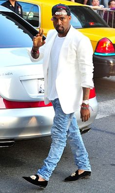 Kanye West in Del Toro Slippers and Snapback