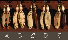 LIGHT AS A FEATHER EARRINGS  Light as a feather, stiff as a board.  Hanging from Shepards Hook wires are hand-carved wooden feathers below wooden barrel beads. Each piece has intricate organic burns, variety of layered stains, and sealed with a jewelry-grade finish. With your choice of 6 different designs, this extraordinarily lightweight piece will bring serious interest from across the room.  #ecofashion #sustainablefashion #bohojewelry #gypsyjewelry #feather