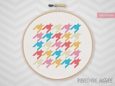 Stitch this colorful pink and blue houndstooth counted cross stitch pattern. The included pdf also includes a separate cross stitch chart and