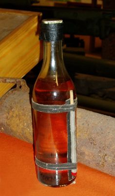 The original design of the Molotov cocktail produced by the Finnish alcohol monopoly Alko during the Winter War of The bottle has storm matches instead of a rag for a fuse. Molotov Cocktail, Storm Photography, Emergency Preparedness Kit, Winter Storm, Survival Tools, God Of War, Toy Boxes, Coups, Hot Sauce Bottles