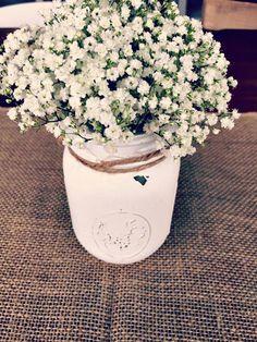 Burlap in distressed white mason jar.