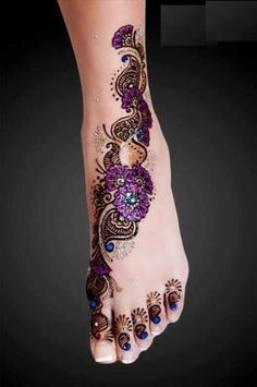 I love this, especially the color but minus the stuff on the toes and I'd go further up the ankle. (yes i'm aware this is Henna but i want i tattooed lol)