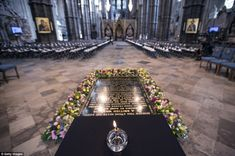 An oil lamp burns next to the 'Grave of the Unknown Warrior' in Westminster Abbey , which is decorated with flowers, ahead of a candlelight vigil attended by the Duchess of Cornwall this evening. Duchess Of Cornwall, Duchess Of Cambridge, British Nobility, New Zealand Tours, Westminster Abbey, Oil Lamps, Duke And Duchess, Wwi, British Royals
