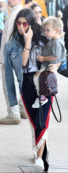 96de442401a Kourtney Kardashian wearing Mickey Mouse Camera Strap