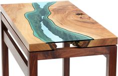 these tables are gorgeous works of art // walnut river hall table by greg klassen