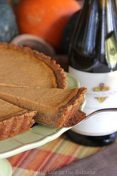 Pumpkin Tart with Gingerbread Cookie Crust  //  The crust is so simple to make - just gingersnap cookies and butter!  Yum!