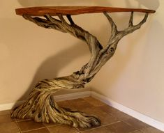 Deadwood table by Eli Ehlinger - the table top is a slice of oak but the base is modelled from sculpting epoxy over a steel frame.