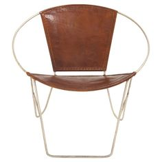Add eye-catching appeal to your living room or den with this stylish accent chair, showcasing a metal frame and leather-upholstered seat. $235