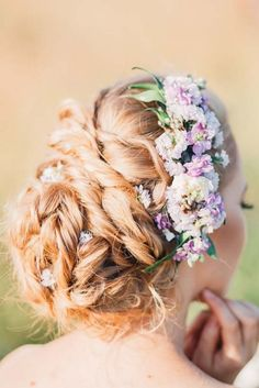 wedding updo hairstyles with lavender flowers via elena radoman