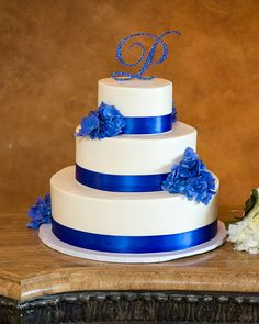 Wedding Cake. Blue and White Monogram with blue hydrangeas.