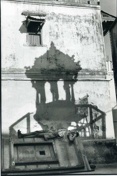 Henri Cartier Bresson Shadows can be used to suggest clues about the context in which the photograph was captured.