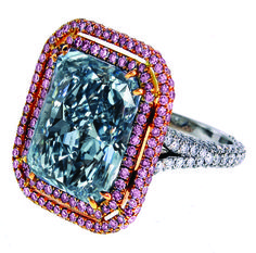 A 12.38-ct. fancy blue radiant cut diamond mounted on a platinum and 18k rose gold ring. The IF clarity diamond is surrounded by 1.01 cts. of fancy pink diamonds and 1.25 cts. of white diamonds in a micro-pave setting. It retails for $12.25 million.