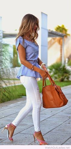 Blogger Helena rocking a Peplum top with a waist belt from Choices and white denim skinny distressed jeans.