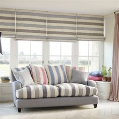 Blinds - LF1634C/2 - Seagull. Seat of Sofa - LF1634C/9 - Marina. Pink Cushion - LF1634C/4 - Deck Chair. Blue Cushion - LF1634C/8 - Beach Hut. Perfect beach interior inspiration.